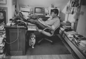 Stephen King working at desk